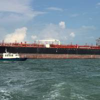 The tanker Alnic MC is seen in Singapore waters after a collision with the USS John S. McCain on Monday. | REUTERS