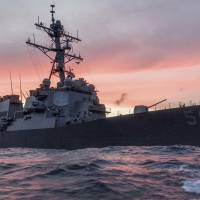 The guided-missile destroyer USS John S. McCain conducts a patrol in the South China Sea in January. | REUTERS