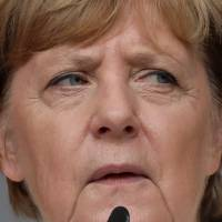 Defiant Merkel takes on protesters at rowdy campaign rally