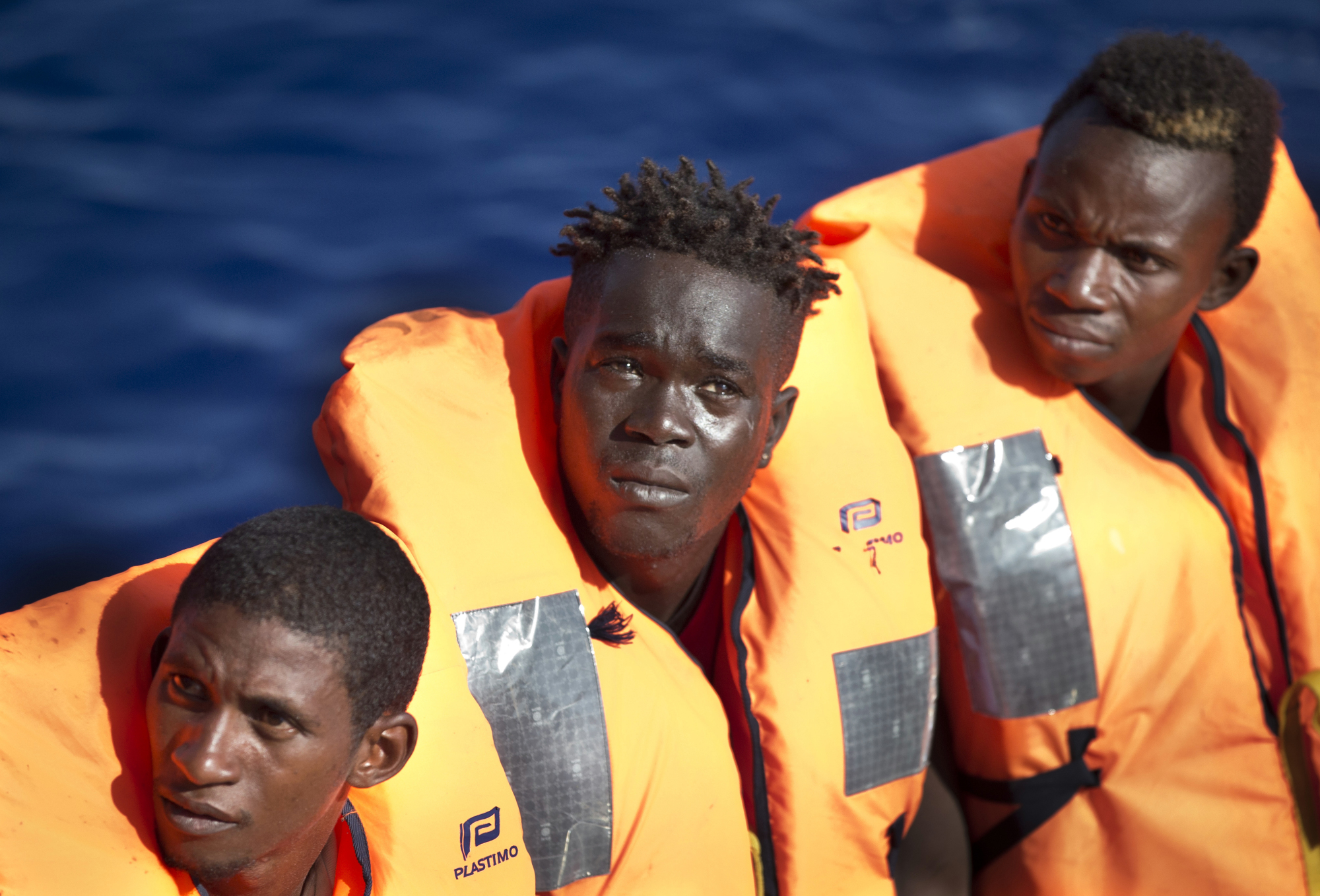 African migrants rescued by an oil rig supply ship are transferred to the Aquarius vessel of SOS Mediterranee and MSF (Doctors Without Borders) NGOs, in the Mediterranean Sea north of Libya Wednesday. | AP