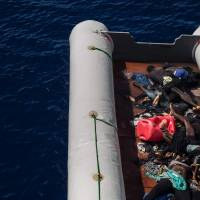 The bodies of migrants lie on a boat after being recovered by the Santa Lucia merchant ship in the Mediterranean Sea, 20 nautic miles from the Libyan coast, on Tuesday. | AFP-JIJI