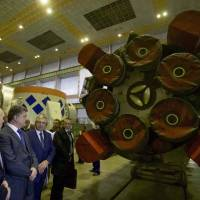 Ukraine's President Petro Poroshenko (second from left) listens to explanations as he visits a rocket engine factory Yuzhmash in Dnipro (Dnipropetrovsk), Ukraine, in  2014. | MYKHAILO MARKIV / UKRAINIAN PRESIDENTIAL PRESS SERVICE / POOL / VIA REUTERS