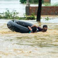 Monsoon floods and landslides kill at least 165 across Nepal, India and Bangladesh