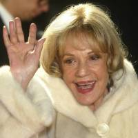 French Actress Jeanne Moreau waves to photographers while on her way to the 16th Annual European Film Awards in Berlin in 2003. | AP