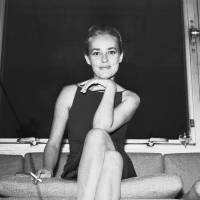 French film actress Jeanne Moreau poses for a photo at London airport, shortly after her arrival from Paris in 1962. | AP