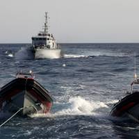 Libyan coast guard threatens Spanish NGO's migrant rescue ship, chases it off