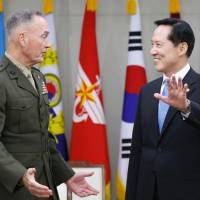 Korea tensions ease slightly as U.S. officials play down war risk
