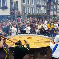 Members of the worldwide fraternity of the omelet prepare a traditional giant omelet made with 10,000 eggs in Malmedy, Belgium, Tuesday. | REUTERS
