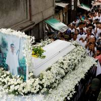 More than a thousand join funeral procession for Philippine teen slain by drug cops