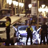One held after attacker drives van into crowd on Barcelona promenade, killing 13, wounding over 50