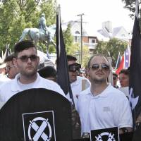 Man held in deadly ramming of protesters pictured earlier with white racist group, sporting their garb