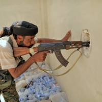 Islamic State fighters trapped in Raqqa, but Chechen snipers slow U.S.-backed forces