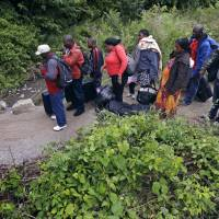 By word of mouth, Trump-fearing migrants in U.S. find NY back road to welcoming Canada
