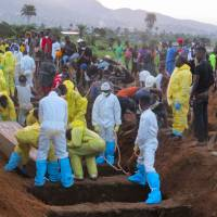 Sierra Leone holds mass burial for over 300, braces for more downpours, mudslides