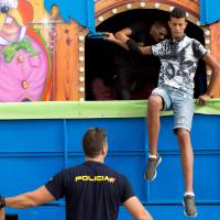 Heartbeat detectors, dogs turn up 30 African migrants hiding in Spain-bound fairground rides in Ceuta