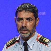 Josep Lluis Trapero, chiefof the Catalan regional police Mossos D'Esquadra', takes part in a press conference at the Generalitat (Catalan Government) in Barcelona on Sunday. Police said they had cast a dragnet for 22-year-old Younes Abouyaaqoub, who media reports say was the driver of a van that smashed into people on Barcelona's busy Las Ramblas boulevard on Aug. 17, killing 13. An extensive operation including roadblocks was deployed across Catalonia, police said, urging people not to disclose information about the checkpoints.   AFP-JIJI