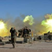 Civilians seen in dire strait as U.S.-backed Iraqi forces try to take Islamic State-held town near Mosul