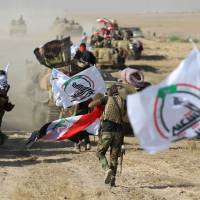 Fighters of the Hashed Al-Shaabi (Popular Mobilization units) advance toward the town of Tal Afar, west of Mosul, after the Iraqi government announced the beginning of the operation to retake it from the control of the Islamic State (IS) group on Tuesday. Iraqi forces recaptured from the Islamic State group the first two districts of jihadi bastion Tal Afar, as the Pentagon chief visited Baghdad in a show of support.   AFP-JIJI