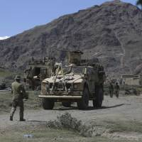 U.S. forces and Afghan commandos are seen in Asad Khil village near the site of a U.S. bombing in the Achin district of Jalalabad, east of Kabul in April. The Taliban have sent an 'open letter' to President Donald Trump, reiterating their calls for America to leave Afghanistan after 16 years of war. | AP