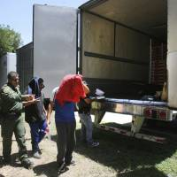 Tip leads police to 17 immigrants locked inside big rig at Texas truck stop