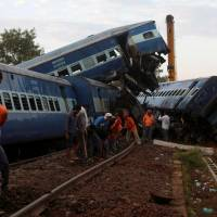 Search on for survivors after at least 23 passengers killed when Indian train plows into homes, college