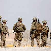 U.S. troops are seen outside their base in Afghanistan's Uruzgan province on July 7. | REUTERS