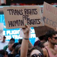 ACLU, other rights groups sue Trump over transgender military ban