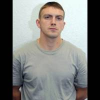 This is an undated photo provided by the Metropolitan Police of former Royal Marine Ciaran Maxwell. A judge sentenced the former Royal Marine to 18 years in prison Monday for a series of terrorism-related offenses. Thirty-one-year-old Ciaran Maxwell lived a double life as a member of the military and as a bombmaker for dissident Irish Republicans. | METROPOLITAN POLICE / VIA AP