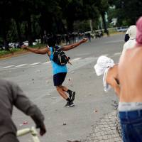 Ruling party boss says troops quashed a 'terrorist' attack on key Venezuela base