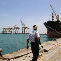 A soldier patrols a pier at the Red Sea port of Hodeidah, Yemen, in May. | REUTERS