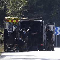 Members of TEDAX-NRBQ (Technician Specialist in Deactivation of Explosive Artifacts) inspect the site where Moroccan suspect Younes Abouyaaqoub was shot on Monday near Sant Sadurni d'Anoia, south of Barcelona, four days after the Barcelona and Cambrils attacks that killed 15 people. Spanish police said they have identified the driver of the van that mowed down pedestrians on the busy Las Ramblas boulevard in Barcelona, killing 13. The 22-year-old Moroccan Younes Abouyaaqoub is believed to be the last remaining member of a 12-man cell still at large in Spain or abroad, with the others killed by police or detained.   AFP-JIJI