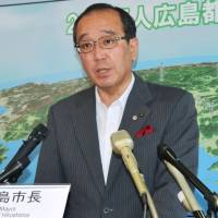 Hiroshima Mayor Kazumi Matsui speaks at a news conference on Tuesday about a peace declaration he will read out during a Sunday ceremony to mark the 72nd anniversary of the U.S. atomic bomb attack on his city. | KYODO