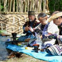 Ainu people pray for their ancestors in Shiranuka, Hokkaido, in August 2015. | KYODO