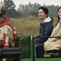 Prince Akishino and his daughter, Princess Mako, ride in a buggy during a visit to Karikas Csarda, a traditional inn in the Great Hungarian Plains near Bugac, 110 km southeast of Budapest, on Sunday. | AP