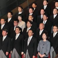 Struggling in polls, Abe puts premium on stability in Cabinet shake-up