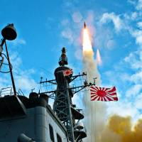 Maritime Self-Defense Force Aegis-class destroyer Kirishima test-fires an SM-3 missile off the island of Kauai, Hawaii, in October 2010. | MARITIME SELF-DEFENSE FORCE / VIA KYODO