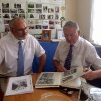 Kevin Degenhard (left), a trustee of the Japan Animal Welfare Society Ltd., and JAWS Chairman Tony Crittenden look through some of the group's archives on July 3 in London. | KYODO