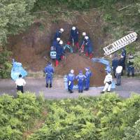 Two held after body of missing woman found buried in Shiga forest