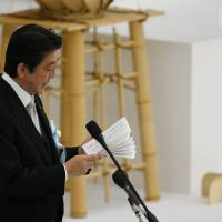 Prime Minister Shinzo Abe delivers his remarks during a memorial service at Nippon Budokan martial arts hall in Tokyo, Tuesday. | AP