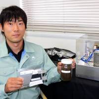 Shizuoka institute boasts storage battery using activated charcoal from coffee grounds
