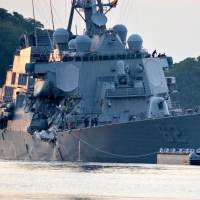 The U.S. Navy Arleigh Burke-class guided-missile destroyer USS Fitzgerald returns to Fleet Activities (FLEACT) Yokosuka following a collision with a merchant vessel while operating southwest of Yokosuka, Kanagawa Prefecture, on June 17. | COURTESY OF U.S. NAVY / MASS COMMUNICATION SPECIALIST 1ST CLASS PETER BURGHART / HANDOUT / VIA REUTERS