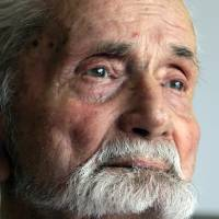 World War II veteran Marvin Strombo is interviewed in Portland, Oregon, on Monday. Strombo took the flag from a dead Japanese soldier in the Pacific theater more than 70 years ago. Now, at age 93, he will return the flag to the man's surviving siblings. | AP