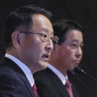 Toyota Motor Corp. President Akio Toyoda (left) and Mazda Motor Corp. President Masamichi Kogai answer a question at a news conference in Tokyo on Friday.   AP