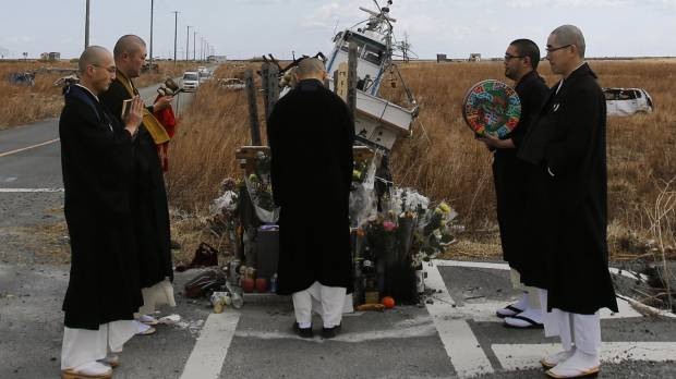 No-go zones keep kin from burying deceased Fukushima evacuees at ancestral gravesites