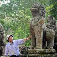 Yoshiaki Ishizawa is seen visiting ruins near Angkor Wat in Cambodia on Aug. 2. | SOPHIA UNIVERSITY / VIA KYODO