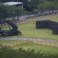 A Patriot Advanced Capability-3 (PAC-3) missile battery is seen at the Defense Ministry in Tokyo on Thursday. | REUTERS