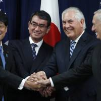 Showing solidarity (from left) Defense Minister Itsunori Onodera, Foreign Minister Taro Kono, Secretary of State Rex Tillerson and Defense Secretary James Mattis do an 'ASEAN style' handshake at the start of a Security Consultative Committee meeting, Thursday at the State Department in Washington. | AP