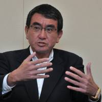 Newly appointed Foreign Minister Taro Kono speaks during a joint interview on Tuesday in Tokyo. | YOSHIAKI MIURA