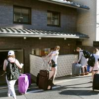 Tourists flocking to the city of Kyoto may see a lodging tax appear on their hotel bills as early as next year. | KYODO
