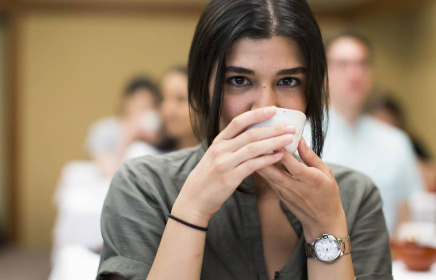 Zeynep Arican drinks a cup of Japanese tea during Mitsubishi UFJ Financial Group Inc.'s global analyst program at Happo-en garden in Tokyo on July 17. | BLOOMBERG